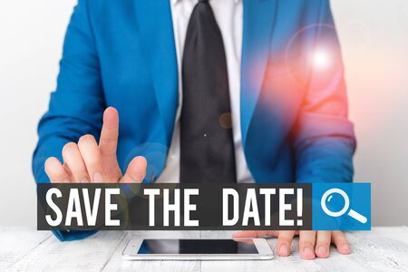 Writing note showing Save The Date. Business concept for remember not schedule anything else on this day Businessman with pointing finger in front of him