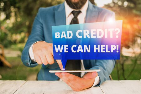 Text sign showing Bad Credit question We Can Help. Business photo showcasing Borrower with high risk Debts Financial Businessman with pointing finger in front of him