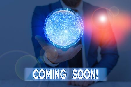 Writing note showing Coming Soon. Business concept for event or action that will happen after really short time Imagens