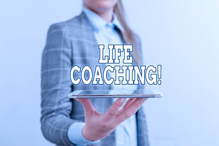 Text sign showing Life Coaching. Business photo text demonstrating employed to help showing attain their goals in career Business concept with mobile phone and business woman Stock Photo