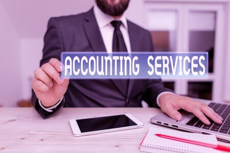 Writing note showing Accounting Services. Business concept for analyze financial transactions of a business or a demonstrating Male human wear formal clothes present use hitech smartphone
