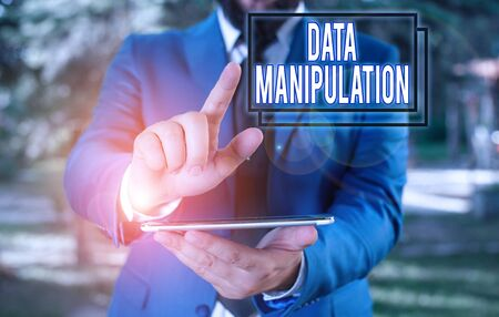 Text sign showing Data Manipulation. Business photo text the process of changing data to make it easier to read Businessman in blue suite with a tie holds lap top in hands
