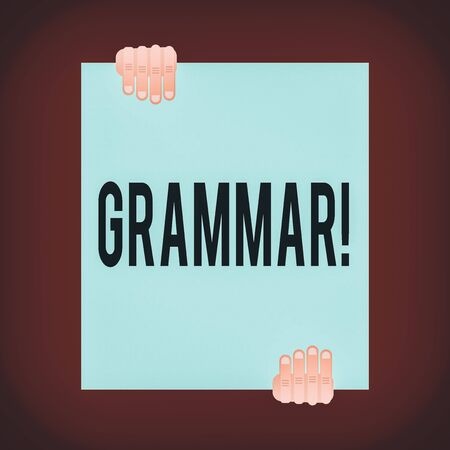 Word writing text Grammar. Business photo showcasing whole system structure language syntax and morphology Two hands hold one big empty blank white paper placed on top and bottom Stok Fotoğraf