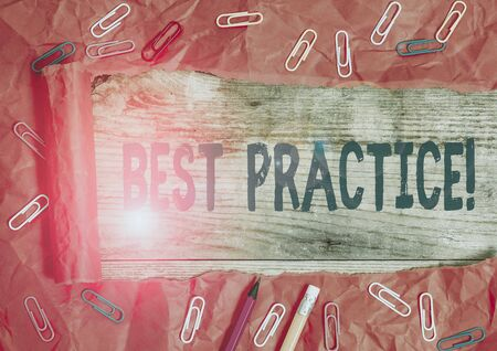 Handwriting text writing Best Practice. Conceptual photo commercial procedures accepted prescribed being correct Stationary and torn cardboard placed above a wooden classic table backdrop