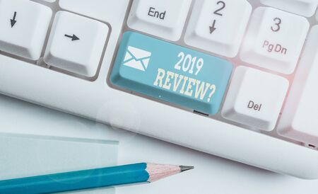 Word writing text 2019 Review Question. Business photo showcasing remembering past year events main actions or good shows White pc keyboard with empty note paper above white background key copy space Standard-Bild