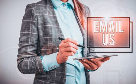 Word writing text Email Us. Business photo showcasing Sending a commercial message to a group of showing using mail Business woman pointing in empty space with pen