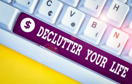 Handwriting text Declutter Your Life. Conceptual photo To eliminate extraneous things or information in life White pc keyboard with empty note paper above white background key copy space
