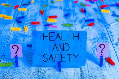 Handwriting text Health And Safety question. Conceptual photo regulations and procedures intended to prevent accident Scribbled and crumbling sheet with paper clips placed on the wooden table