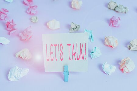 Writing note showing Let S Talk. Business concept for they are suggesting beginning conversation on specific topic Colored crumpled papers empty reminder pink floor background clothespin