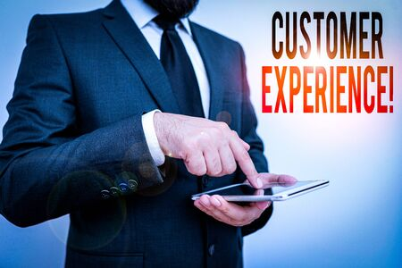 Word writing text Customer Experience. Business photo showcasing product of interaction between organization and buyer Male human wear formal clothes present presentation use hi tech smartphone
