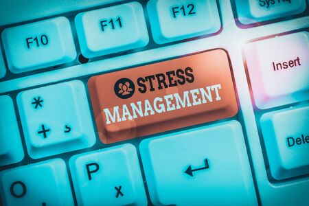 Conceptual hand writing showing Stress Management. Concept meaning method of limiting stress and its effects by learning ways White pc keyboard with note paper above the white background