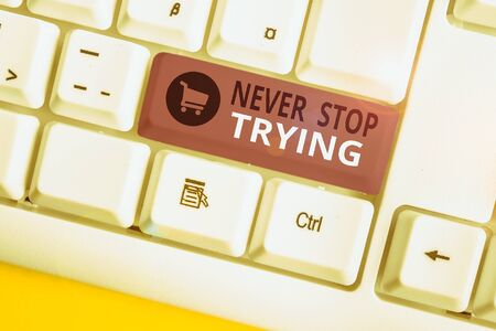 Writing note showing Never Stop Trying. Business concept for Do not give up Continue to Try Again Keep on Doing White pc keyboard with note paper above the white background