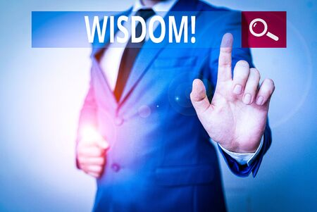 Conceptual hand writing showing Wisdom. Concept meaning quality having experience knowledge and good judgement something Businessman with pointing finger in front of him Stock fotó