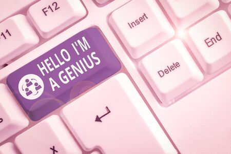 Writing note showing Hello I M A Genius. Business concept for Introduce yourself as over average demonstrating to others White pc keyboard with note paper above the white background Stock fotó