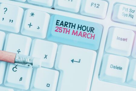 Writing note showing Earth Hour 25Th March. Business concept for symbol commitment to planet Organized World Wide Fund White pc keyboard with note paper above the white background