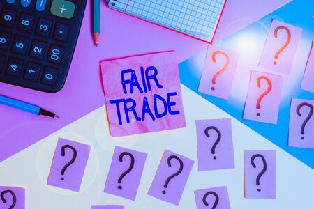 Handwriting text Fair Trade. Conceptual photo buying goods directly from producers in developing countries Mathematics stuff and writing equipment above pastel colours background 版權商用圖片