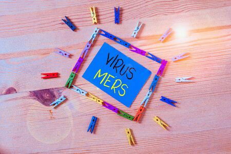 Word writing text Virus Mers. Business photo showcasing viral respiratory illness that first reported in Saudi Arabia Colored clothespin papers empty reminder wooden floor background office Archivio Fotografico