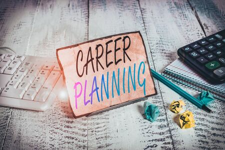 Writing note showing Career Planning. Business concept for Strategically plan your career goals and work success Notepaper on wire in between computer keyboard and sheets
