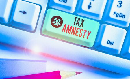 Writing note showing Tax Amnesty. Business concept for limitedtime opportunity for specified group of taxpayers to pay