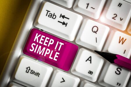 Writing note showing Keep It Simple. Business concept for to make something easy to understand and not in fancy way White pc keyboard with note paper above the white background