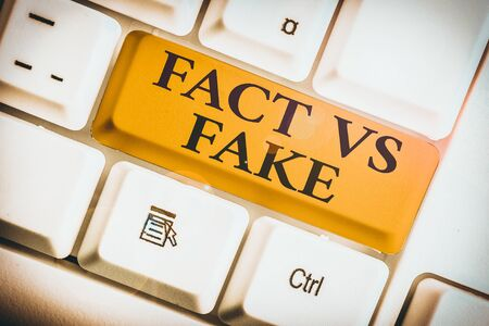 Text sign showing Fact Vs Fake. Business photo showcasing Rivalry or products or information originaly made or imitation 写真素材