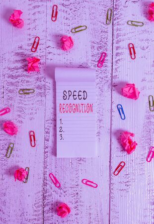 Writing note showing Speed Recognition. Business concept for technology used to detect and recognize over speeding car Stripped ruled notepad clips paper balls wooden background Stock fotó