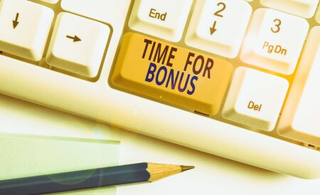 Word writing text Time For Bonus. Business photo showcasing a sum of money added to a demonstrating s is wages as a reward White pc keyboard with empty note paper above white background key copy space