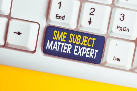 Conceptual hand writing showing Sme Subject Matter Expert. Concept meaning Authority in a particular area or topic Domain White pc keyboard with note paper above the white background