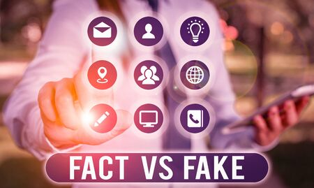Text sign showing Fact Vs Fake. Business photo showcasing Rivalry or products or information originaly made or imitation Stock Photo