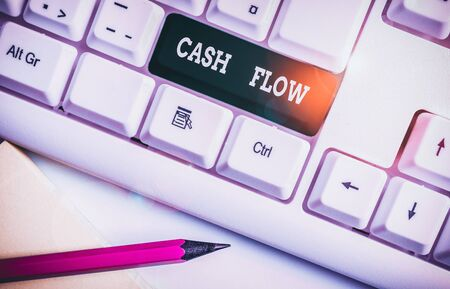 Writing note showing Cash Flow. Business concept for Movement of the money in and out affecting the liquidity White pc keyboard with note paper above the white background Stock fotó