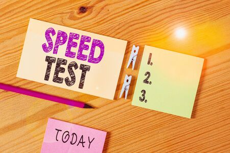 Conceptual hand writing showing Speed Test. Concept meaning psychological test for the maximum speed of performing a task Colored crumpled papers wooden floor background clothespin Stock Photo