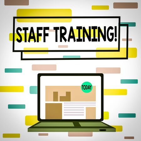 Writing note showing Staff Training. Business concept for program that helps employees learn specific knowledge Laptop Switched On with Website Homepage Screen Web Search