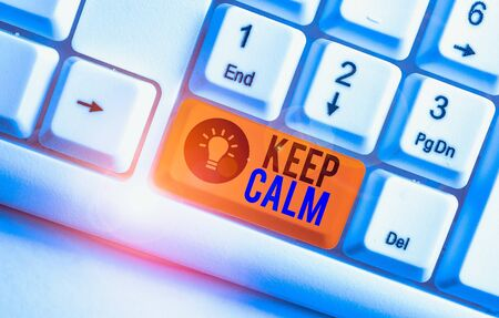 Handwriting text Keep Calm. Conceptual photo not get emotionally invested in situations you cannot control over White pc keyboard with empty note paper above white background key copy space