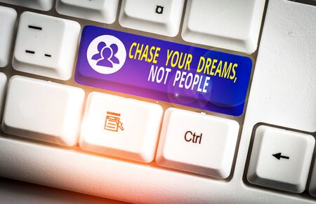 Handwriting text writing Chase Your Dreams Not People. Conceptual photo Do not follow others chasing goals objectives White pc keyboard with empty note paper above white background key copy space