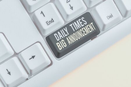 Conceptual hand writing showing Daily Times Big Announcement. Concept meaning bringing actions fast using website or tv White pc keyboard with note paper above the white background