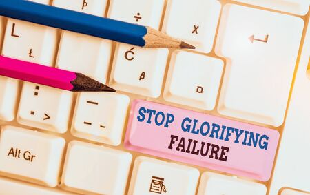 Handwriting text Stop Glorifying Failure. Conceptual photo do not let Breakdown Rule your life Try again White pc keyboard with empty note paper above white background key copy space 版權商用圖片