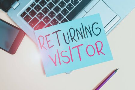 Writing note showing Returning Visitor. Business concept for when someone returns to your website multiple times Metallic laptop small paper sheet pencil smartphone colored background