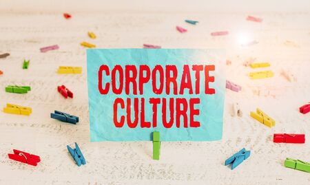 Word writing text Corporate Culture. Business photo showcasing beliefs and attitudes that characterize a company Green clothespin white wood background colored paper reminder office supply