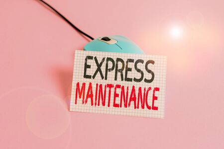 Writing note showing Express Maintenance. Business concept for damage is immediately debited to repairs and maintenance Wire vintage electronic mouse squared paper sheet colored background