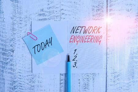 Writing note showing Network Engineering. Business concept for field concerned with internetworking service requirement Open squared notepad clip note highlighter lying old wooden background