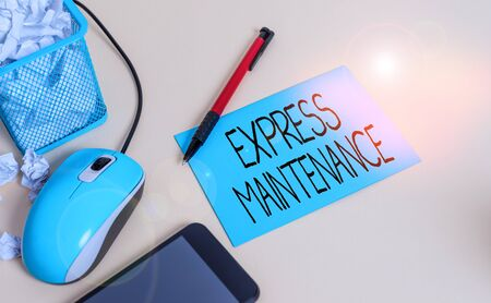 Conceptual hand writing showing Express Maintenance. Concept meaning damage is immediately debited to repairs and maintenance crumpled paper in bin placed next to modern gadget and stationary