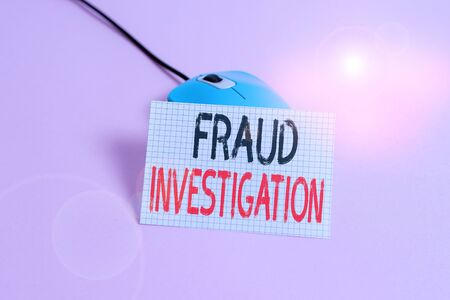 Writing note showing Fraud Investigation. Business concept for process of determining whether a scam has taken place Wire vintage electronic mouse squared paper sheet colored background Zdjęcie Seryjne