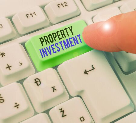 Conceptual hand writing showing Property Investment. Concept meaning Asset purchased and held primarily for its future income