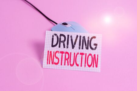 Writing note showing Driving Instruction. Business concept for detailed information on how driving should be done Wire vintage electronic mouse squared paper sheet colored background