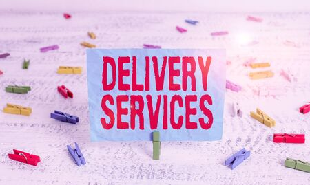 Word writing text Delivery Services. Business photo showcasing the transport of items between two or more parties Green clothespin white wood background colored paper reminder office supply
