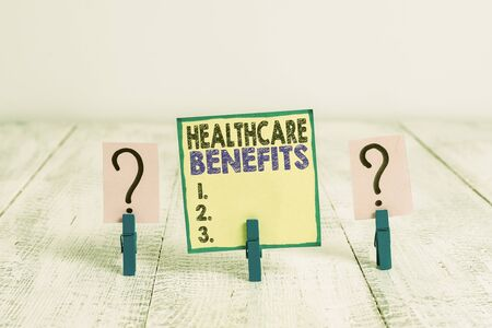 Handwriting text writing Healthcare Benefits. Conceptual photo use the health services without risk of financial ruin Scribbled and crumbling sheet with paper clips placed on the wooden table Stok Fotoğraf