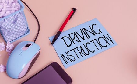 Conceptual hand writing showing Driving Instruction. Concept meaning detailed information on how driving should be done crumpled paper in bin placed next to modern gadget and stationary Reklamní fotografie