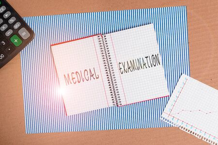 Word writing text Medical Examination. Business photo showcasing Checkup carried out to determine the physical fitness Striped paperboard notebook cardboard office study supplies chart paper