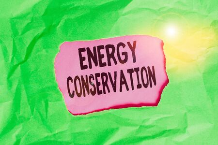 Word writing text Energy Conservation. Business photo showcasing Reduction in the amount of energy consumed in a process Green crumpled ripped colored paper sheet centre torn colorful background Reklamní fotografie