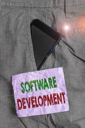 Handwriting text Software Development. Conceptual photo software is created using a specific programming Smartphone device inside formal work trousers front pocket near note paper